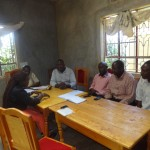 The Water Project: Emukangu Primary School -  Staff Meeting With Administration