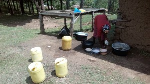 The Water Project:  Cook Washing Utensils