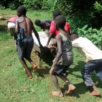 The Water Project: Eluhobe Community -  Community Children Work As A Team To Get Materials At The Spring