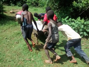 The Water Project:  Community Children Work As A Team To Get Materials At The Spring
