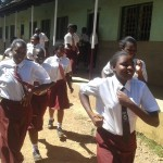 The Water Project: Bishop Sulumeti Girls Secondary School -  Students Rush To Latrines At Break