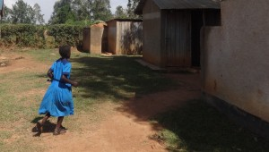 The Water Project:  Girl Rushes To Use Latrines