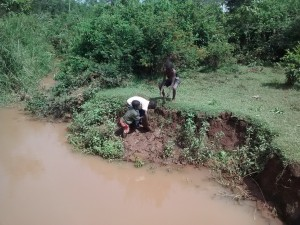 The Water Project : 13-kenya4710-children-get-local-materials-covered-by-the-flooding-waters