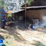 The Water Project: Shiamboko Community, Oluchinji Spring -  Claire And Her Son Preparing Lunch For The Family