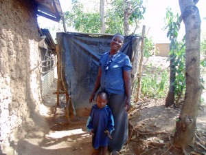 The Water Project:  Claire Poses With Her Son Next To Her Bathroom