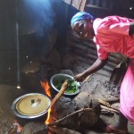 The Water Project: Chief Mutsembe Primary School -  Mrs Leah The School Cook Prepares A Meal For Staff