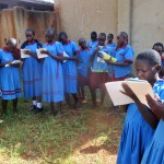 The Water Project: ADC Chanda Primary School -  Children Taking Notes On Hand Washing