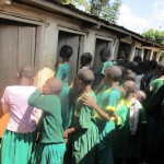 The Water Project : 14-kenya4663-girls-line-up-for-latrines