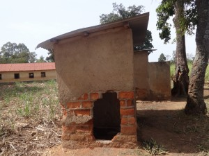 The Water Project:  Hole In Latrine Wall