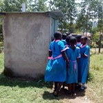 The Water Project: Maganyi Primary School -  Girls Waiting