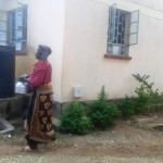 The Water Project : 15-kenya4670-cook-drawing-water-from-storage-tank