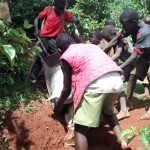 The Water Project: Eluhobe Community -  Children Passionately Helping To Ferry Cement Along A Rugged Terrain To The Spring Construction Site
