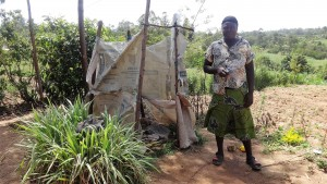 The Water Project:  Mrs Egesa Beside Her Latrine