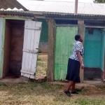 The Water Project: Eshisuru Primary School -  Teacher Showing Us The Latrines