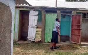 The Water Project:  Teacher Showing Us The Latrines