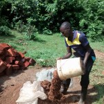 The Water Project : 16-kenya4710-community-member-helps-with-cement-work