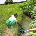 The Water Project: Kulufai Rashideen Secondary School -  Student Fetching Water