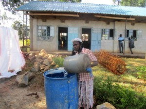 The Water Project:  Parent Fetches Construction Water