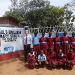 The Water Project: Emulakha Primary School -  Headteacher Poses With Students At School Gate