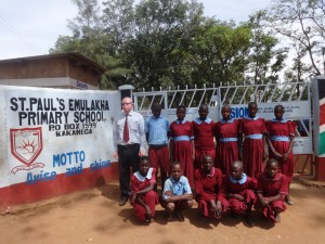 The Water Project:  Headteacher Poses With Students At School Gate