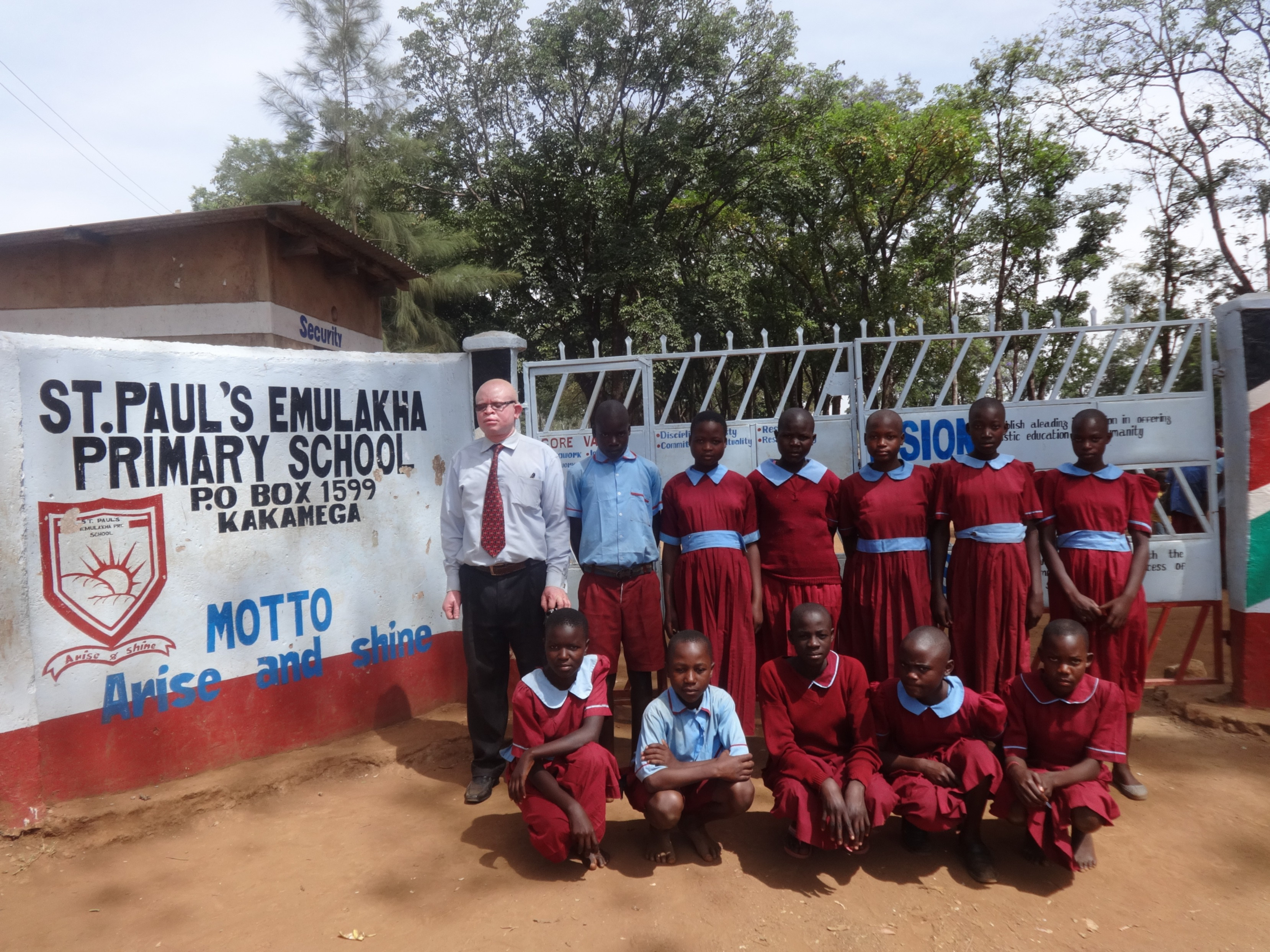 The Water Project : 2-kenya4678-headteacher-poses-with-students-at-school-gate