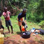 The Water Project: Shitaho Community C -  Woman Washing Her Clothes During Training
