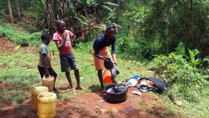 The Water Project:  Woman Washing Her Clothes During Training