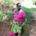 The Water Project: Igogwa Community -  Mrs Jane Igunza At The Spring