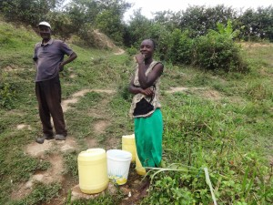 The Water Project:  Miriam And Her Husband At The Spring