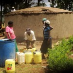 The Water Project: Bumuyange Secondary School -  Collecting Construction Water