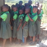 The Water Project: Emusoma Primary School -  Girls Lined Up For Latrines