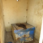 The Water Project: Kitonki Community, War Wounded Camp -  Inside Latrine