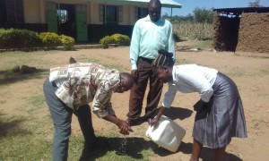 The Water Project : 21-kenya4692-staff-demonstrates-hand-washing