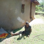 The Water Project : 22-kenya4732-old-widow-relaxes-at-her-home
