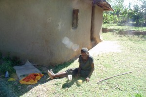 The Water Project:  Old Widow Relaxes At Her Home