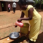 The Water Project: Emukangu Primary School, Butere -  Teacher Demonstrates Hand Washing