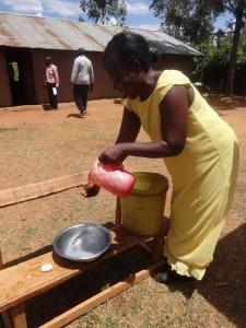The Water Project : 23-kenya4677-teacher-demonstrates-hand-washing