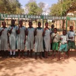 The Water Project: Eshisuru Primary School -  Teacher Poses With Students