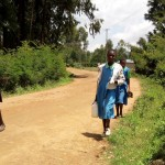 The Water Project: Musunji Primary School -  Girl Carries Water To School