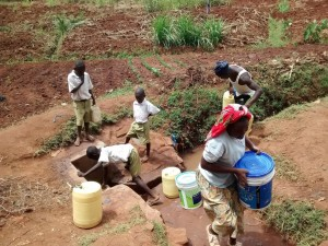 The Water Project:  Students Fetch Water At Community Spring