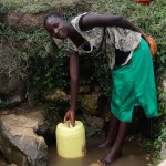 The Water Project: Shitungu Community B, Charles Amala Spring -  Miriam Fetches Water At Amala Spring