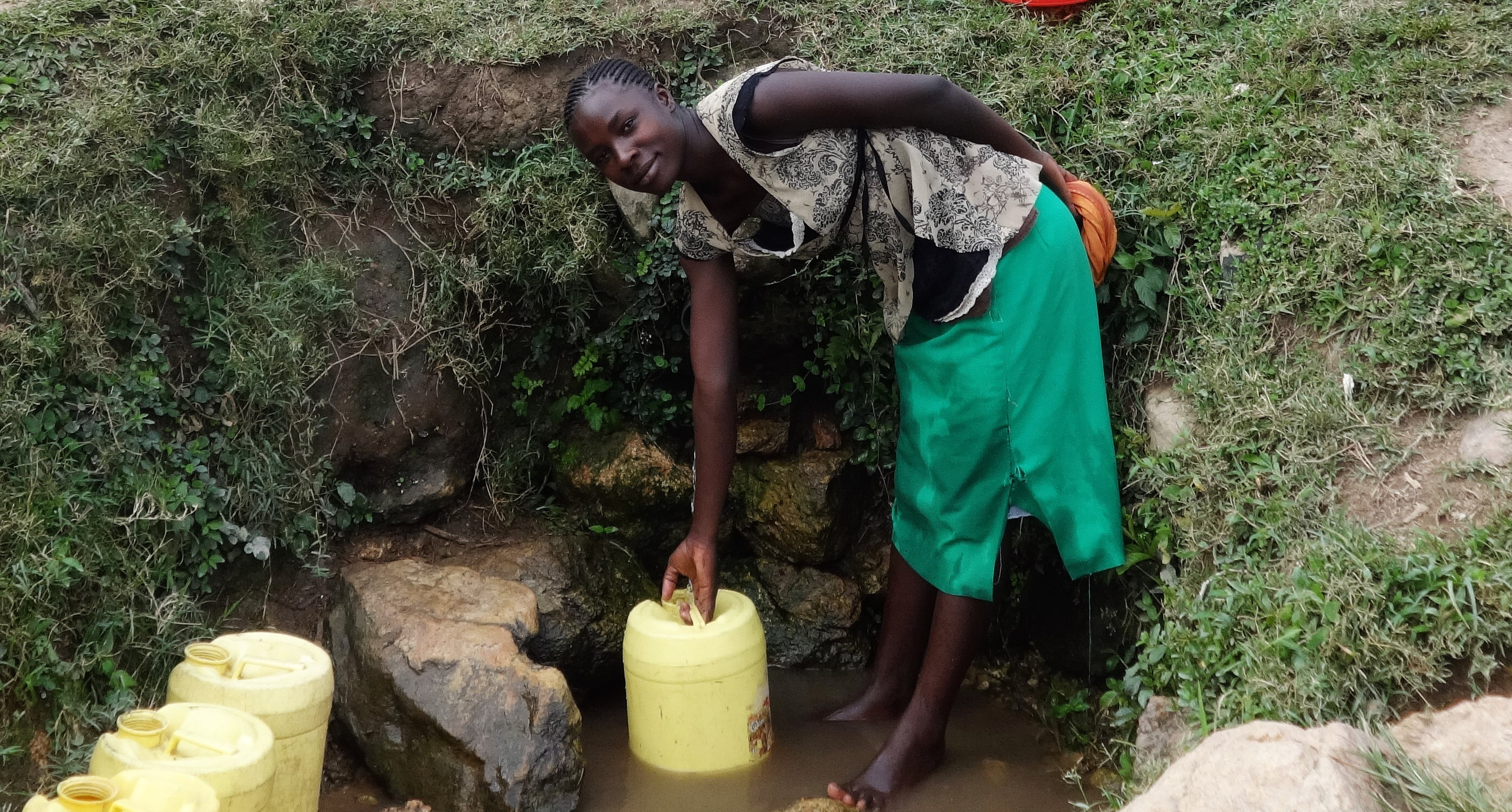 The Water Project : 3-kenya4731-miriam-fetches-water-at-amala-spring