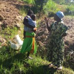 The Water Project : 3-kenya4754-mrs-amboka-talking-about-her-community