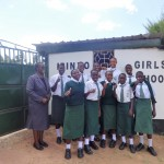 The Water Project: Ibinzo Girls Secondary School -  Students Pose With Principal At School Gate