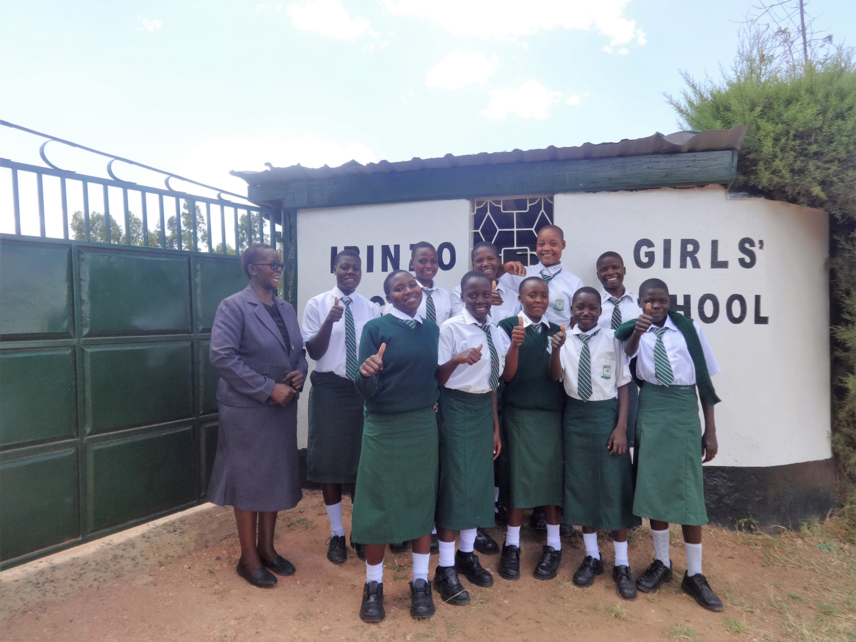 The Water Project : 4-kenya4669-students-pose-with-principal-at-school-gate