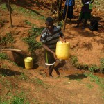 The Water Project: Shikhuyu Community -  Fetching Water