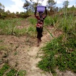 The Water Project: Bukhakunga Community -  Carrying Water
