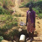 The Water Project: Futsi Fuvili Community -  Lady Waits For Her Jerrycan To Fill