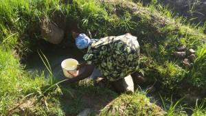The Water Project:  Mrs Amboka Fetching Water