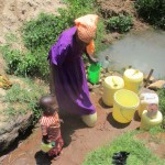 The Water Project: Mulundu Community -  Women Bring Their Children With Them To Fetch Water